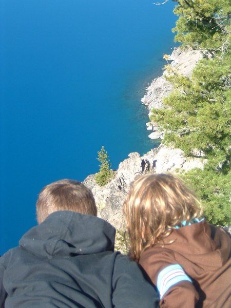 The Nelsen kids checking out Crater Lake.  The lake is actually at least 2,000' below although it looks quite a bit closer.  Nice view of the quick dropoff in the landscape under the water.
